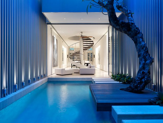 A room with a pool in front of a building